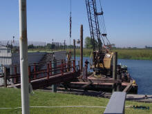 Tug boat and spud barge repairing dock pilings at Bethel Island